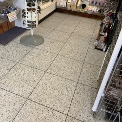 Luxury Vinyl Tile in Grey Terrazo Finish with Dark Grey Grout