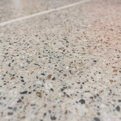 Luxury Vinyl Tile in Polished Concrete with Custom Grout